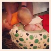 20 month old Kash, kisses his baby brother.